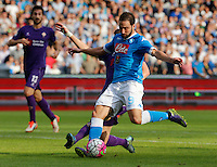 Napoli's Gonzalo Higuain shoots and scores during the Italian Serie A soccer match between SSC Napoli and AC Fiorentina  at San Paolo stadium in Naples,October 18, 2015