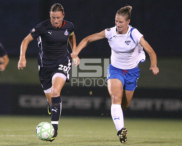 Abby Wambach #20 of the Washington Freedom tries to break away from Maggie Tomecks #5 of the Boston Breakers during a WPS match at Maryland Soccerplex on July 29, in Boyds, Maryland. Freedom won 1-0.