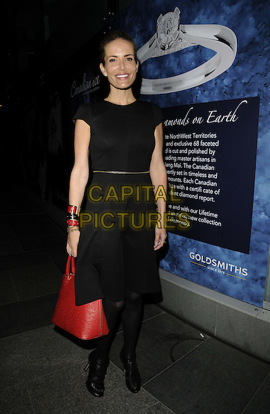 SOPHIE ANDERTON .The Canadian Ice Diamonds ethical jewellery collection UK launch, Goldsmiths boutique, Victoria St., London, England..September 22nd, 2011.full length black dress tights red bag purse .CAP/CAN.©Can Nguyen/Capital Pictures.