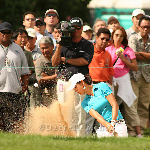 January 13, 2005; Honolulu, HI, USA;  15 year old amateur Michelle Wie hits out of a sand trap on the 8th hole during the 1st round of the PGA Sony Open golf tournament held at Waialae Country Club.  Wie shot a 5 over par 75 for the day.<br />Mandatory Credit: Photo by Darrell Miho <br />&copy; Copyright Darrell Miho