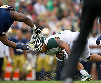 Louis Nix (1) pulls the helmet off Michigan State Spartans running back Nick Hill (20) in the second quarter at Notre Dame Stadium. Nix was called for a face mask penalty.