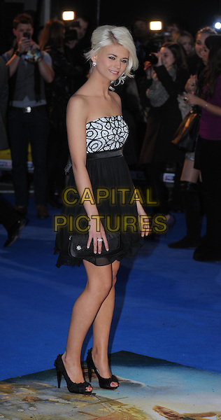 Danielle Harold.'The Adventures of Tintin: The Secret of the Unicorn' UK film premiere, 55th BFI London Film Festival, Odeon West End cinema, Leicester Square, London, England..23rd October 2011.LFF full length black white print strapless dress clutch bag  side.CAP/WIZ.© Wizard/Capital Pictures.