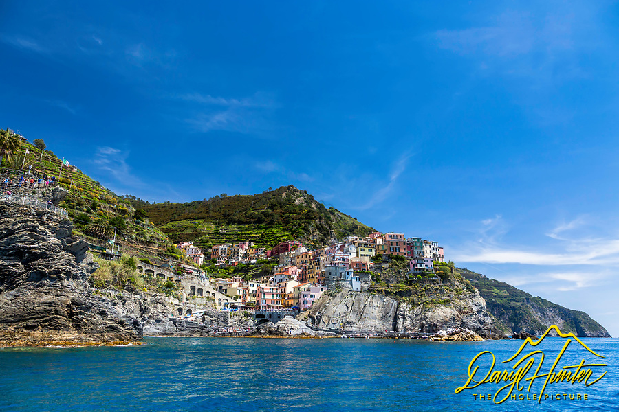 Manarola from the sea.  Manarola is one of the cliff clinging villages of Cinque Terre on the Italian Riviera.