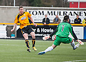 Forfar keeper Darren Hill saves Alloa's Calum Elliot's shot at close range.