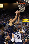 Akron forward Jaden Sayles lays the ball up against Nevada in the second half of an NCAA college basketball game in Reno, Nev., Saturday, Dec. 22, 2018. (AP Photo/Tom R. Smedes)