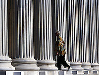 01 NOV 2003 - ATHENS, GREECE - A visitor walks through the entrance into the Zappeion. (PHOTO (C) NIGEL FARROW)