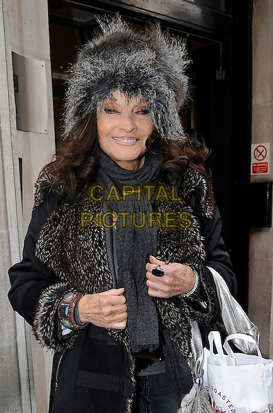 Kate O'Mara leaving BBC Radio 2, London, England..17th January, 2012.half length black grey gray fur hat coat jacket scarf  .CAP/IA.©Ian Allis/Capital Pictures.