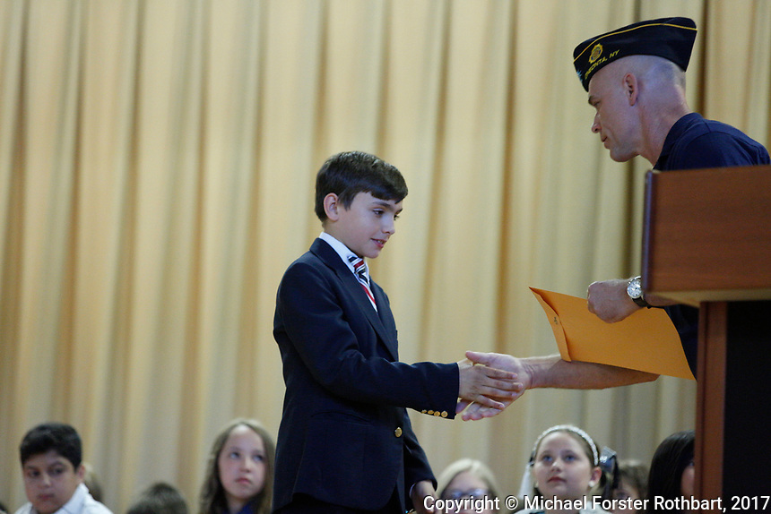 The Oneonta Greater Plains elementary school fifth grade awards ceremony, on June 21, 2017.<br /> &copy; Michael Forster Rothbart Photography<br /> www.mfrphoto.org &bull; 607-267-4893<br /> 34 Spruce St, Oneonta, NY 13820<br /> 86 Three Mile Pond Rd, Vassalboro, ME 04989<br /> info@mfrphoto.org<br /> Photo by: Michael Forster Rothbart<br /> Date:  6/21/2017<br /> File#:  Canon &mdash; Canon EOS 5D Mark III digital camera frame C19168