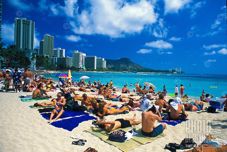 Famous  Diamond head & Waikiki beach lined with tourists on a sunny day