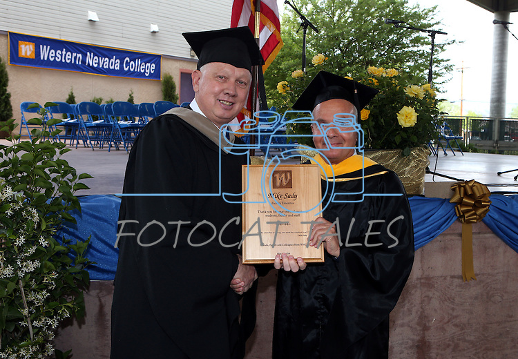 Interim President Chester Burton recognizes Faculty Emeriti recipient Mike Sady before the Western Nevada College commencement at the Pony Express Pavilion, in Carson City, Nev., on Monday, May 19, 2014. <br /> Photo by Cathleen Allison/Nevada Photo Source