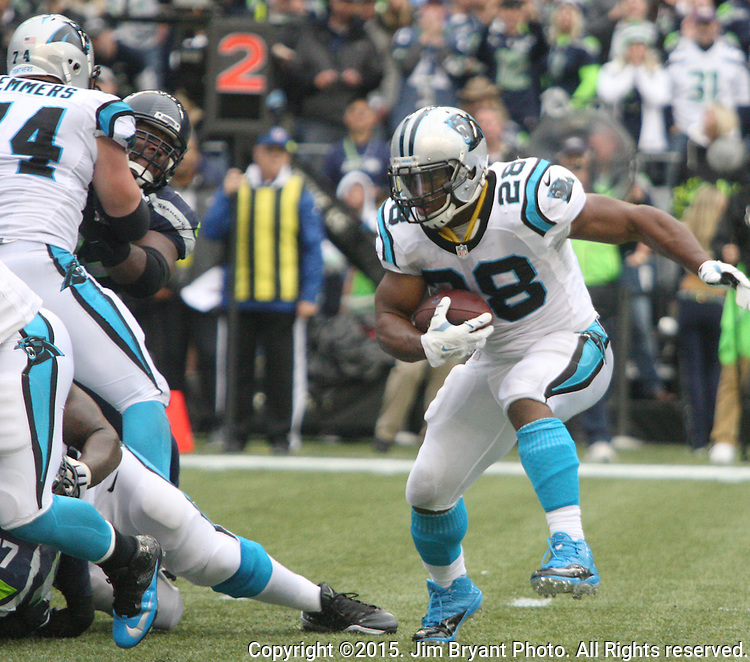 Carolina Panthers  running back Jonathan Stewart (28) looks for an opening against the Seattle Seahawks CenturyLink Field in Seattle on October 18, 2015. The Panthers came from behind with 32 seconds remaining in the 4th Quarter to beat the Seahawks 27-23.  ©2015 Jim Bryant Photography. All Rights Reserved.