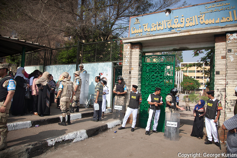 Scenes outside a polling station in Shubra, Cairo<br /> <br /> The police and army were present in full riot gear at the Polling stations.