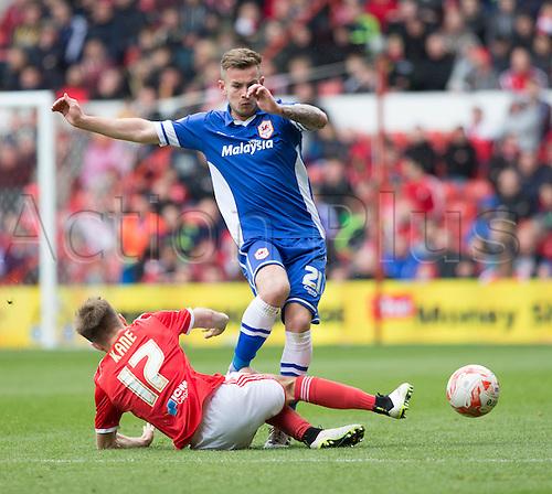 02.05.2015.  Nottingham, England. Skybet Championship. Nottingham Forest versus Cardiff. Nottingham Forest defender Todd Kane sliding tackle on Cardiff City midfielder Joe Ralls.