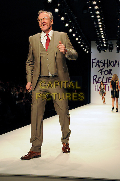 LARRY LAMB.The Fashion For Relief Haiti 2010 show for London Fashion Week Autumn/Winter 2010 at Somerset House, London, England..February 18th, 2010.LFW catwalk runway full length beige suit brown waistcoat glasses .CAP/CAS.©Bob Cass/Capital Pictures.