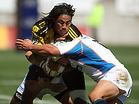 Hurricanes second five Ma'a Nonu crashes into the tackle of Heinrich Brussow..Super 14 rugby union match, Hurricanes v Cheetahs at Yarrows Stadium, New Plymouth, New Zealand. Saturday 7 March 2009. Photo: Dave Lintott / lintottphoto.co.nz