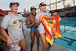 LOS ANGELES, CA - DECEMBER 03:  Nicolas Saveljic (21) and Max Irving (19) of the University of California Los Angeles celebrate after the Division I Men's Water Polo Championship held at the Uytengsu Aquatics Center on the University of Southern California campus on December 3, 2017 in Los Angeles, California. UCLA defeated USC 5-7 to win the National Championship. (Photo by Justin Tafoya/NCAA Photos via Getty Images)