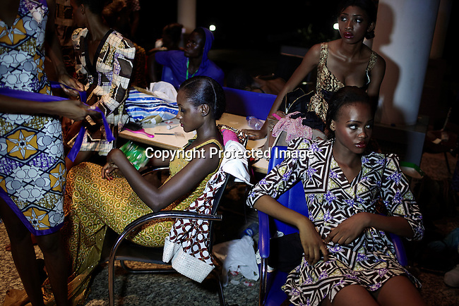 ABUJA, NIGERIA MAY 26: Models wait backstage before a fashion show launching ECOWAS fashion week on May 26, 2013 in Abuja, Nigeria. Nigerian and invited African designers showcased their collections during one night only show. (Photo by: Per-Anders Pettersson)