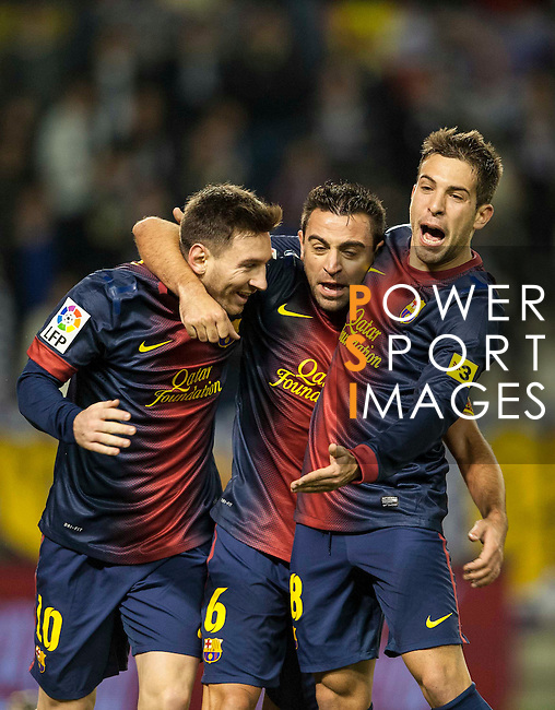 VALLADOLID, SPAIN - DECEMBER 22:  Xavi Hernandez of FC Barcelona celebrates with his teammates Lionel Messi and Jordi Alba after scoring against Real Valladolid at Jose Zorrilla on December 22, 2012 in Valladolid, Spain.  Photo by Victor Fraile / The Power of Sport Images