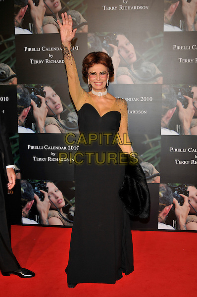 SOPHIA LOREN .Attends the Pirelli Calendar 2010 Gala Dinner, Old Billingsgate, Old Billingsgate Walk, London, England, UK,.20th November 2009..full length black strapless long maxi dress gold sleeves beaded sheer see thru through mesh hand waving .CAP/PL.©Phil Loftus/Capital Pictures.