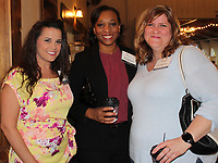 NWA Democrat-Gazette/CARIN SCHOPPMEYER Erin Goodwin (from left), Sheerah Davis and Pauli Springer visit at the CASA Celebration.