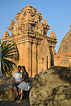 Asia, Vietnam, Nha Trang. Po Nagar Cham Towers. A young vietnamese couple posing for a photograph. The Cham Towers dating back to the 7-12 century are located just north of the city centre at the mouth of the Cai River.