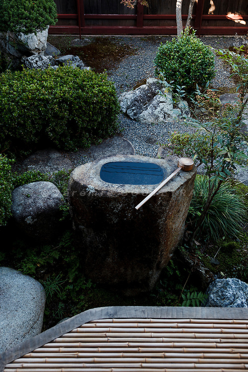 Hino, Shiga prefecture, October 6 2013 - Water basin in the front garden of the 150-year-old traditional house renovated by Mr Austin Moore and his wife.