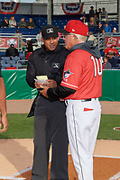 Batavia Muckdogs manager Tom Lawless (10) during the lineup exchange with umpire Rainiers Valero before a NY-Penn League game against the Auburn Doubledays on June 14, 2019 at Dwyer Stadium in Batavia, New York.  Batavia defeated 2-0.  (Mike Janes/Four Seam Images)