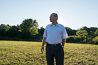 Dr. Ihab Dabbagh, former president and board member of the Islamic Society, is  seen here in Dudley, Massachusetts, on Tues., Aug 23, 2016, on a plot of land that the Islamic Society is trying to buy to create a Muslim cemetery for the community. The nearest Muslim cemetery is in Enfield, Connecticut, and many of the group's relatives are buried there. The group is looking for a place closer to Worcester to bury their loved ones but has encountered substantial opposition from locals and town officials. Dabbagh is a Syrian immigrant who came to Worcester in 1998 to open a dental practice; he now lives in nearby Shrewsbury, Mass.