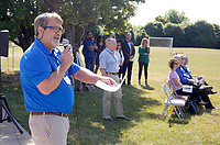 NWA Democrat-Gazette/DAVID GOTTSCHALK  Mike Gilbert (left), chief operating officer of the Jones Trust, announces Tuesday, June 5, 2018, the creation of The Runway Bicycle Skills Park at the Jones Center in Springdale. The park will have the largest asphalt pump track in North America and will host the Pump Track (bicycling) World Championships sponsored by Red Bull in October.