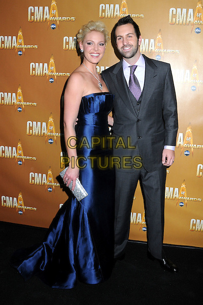 KATHERINE HEIGL & JOSH KELLEY .44th Annual CMA Awards, Country Music's Biggest Night, held at Bridgestone Arena, Nashville, Tennessee, USA, 10th November 2010..CMAs country music full length couple suit tie married husband wife arm around dress purple grey gray strapless blue long maxi dress silver clutch bag .CAP/ADM/LF.©Laura Farr/AdMedia/Capital Pictures.