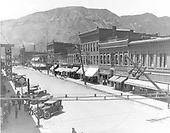 Main Ave. looking south.  Paved street, automobiles - no street cars.  &quot;Parsons Drugs&quot; on left, Strater Hotel in distance.<br /> Durango, CO  ca 1930-1935