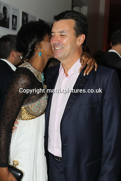 NON EXCLUSIVE PICTURE: TREVOR ADAMS / MATRIXPICTURES.CO.UK<br /> PLEASE CREDIT ALL USES<br /> <br /> WORLD RIGHTS<br /> <br /> British-American singer Sinitta Renay Malone and Nick Cowell, the brother of English X Factor music mogul Simon Cowell, attending the CANDY Magazine Autumn/Winter 2013 Launch Party, hosted by Nick Candy at the Saatchi Gallery in King's Road, London.<br /> <br /> OCTOBER 15th 2013<br /> <br /> REF: MTX 136759