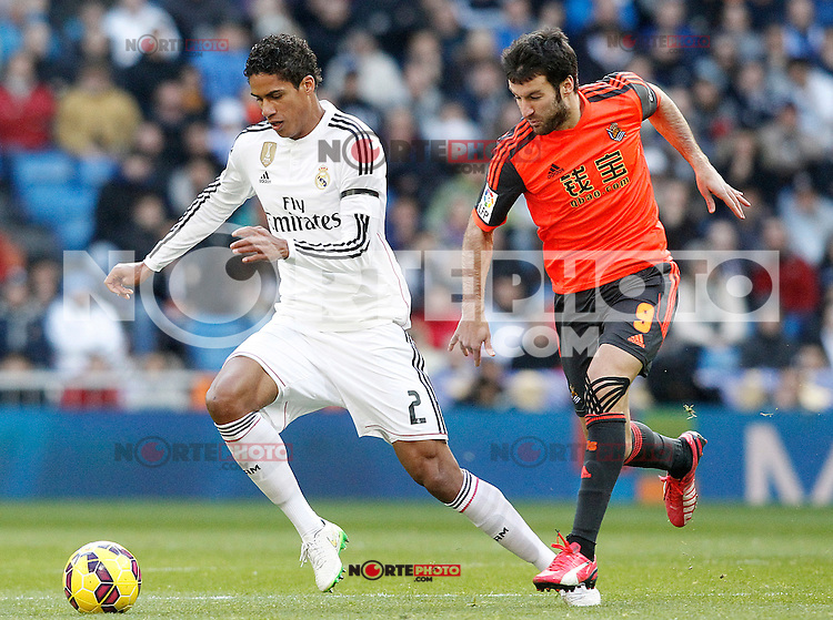 Real Madrid's Raphael Varane (l) and Real Sociedad's Imanol Agirretxe during La Liga match.January 31,2015. (ALTERPHOTOS/Acero) /NortePhoto<br />