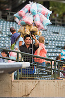 A cotton candy and popcorn vendor sells his wares at Smith's Ballpark as the Salt Lake Bees faced the Tacoma Rainiers on September 1, 2015 in Salt Lake City, Utah.  (Stephen Smith/Four Seam Images)