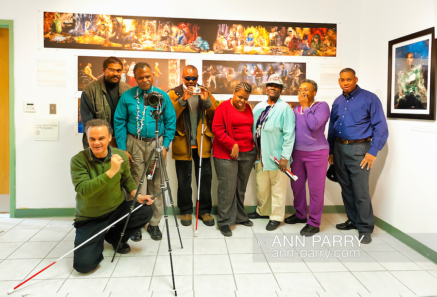 """Artist Reception for Seeing with Photography Collective SWPC, a group of visually impaired, sighted and totally blind photographers based in NYC, on Saturday, April 28, 2012, at African American Museum, Hempstead, New York, USA. Group photo of photographers included are (standing) starting one person in from left:  John Gardner, Dale Layne, Tameka Cooper, Victorine Floyd Fludd, Marion Sheppard, and Hasheem Kirkland. Exhibit hosted by Long Island Center of Photography. Aperture published the group's """"Shooting Blind: Photographs by the Visually Impaired"""" in 2005."""