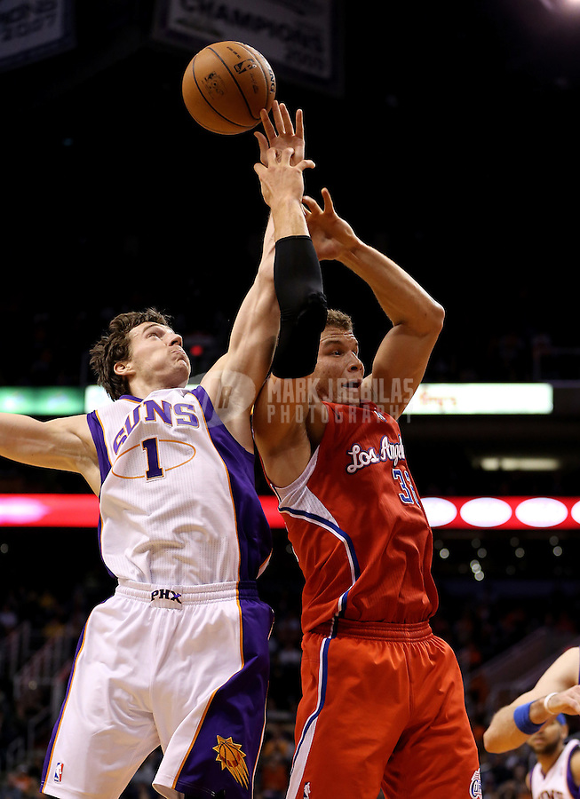 Jan. 24, 2013; Phoenix, AZ, USA: Los Angeles Clippers forward Blake Griffin (32) has the ball stolen by Phoenix Suns guard Goran Dragic (1) at the US Airways Center. The Suns defeated the Clippers 93-88. Mandatory Credit: Mark J. Rebilas-USA TODAY Sports