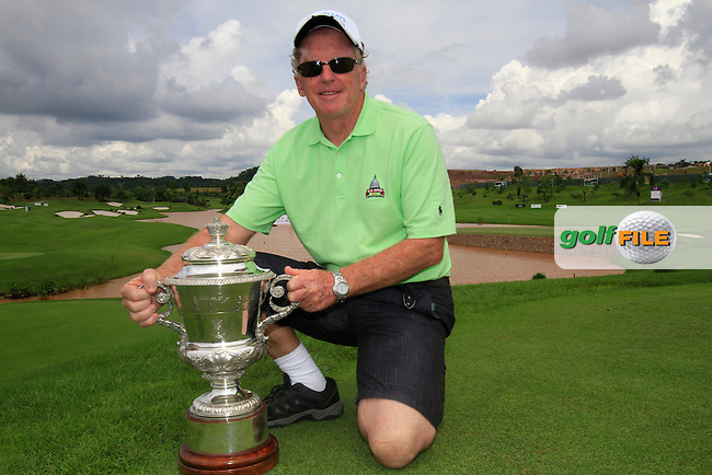 Renowned golf journalist Bernie McGuire pictured with the winners trophy on the 10th tee box during Tuesday's Pro-Am 2011 Iskandar Johor Open, Horizon Hills Golf Club, Johor, Malaysia, 15th November 2011 (Photo Eoin Clarke/www.golffile.ie)