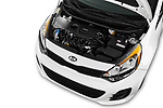 Car Stock 2016 KIA Rio LX 5 Door Hatchback Engine  high angle detail view