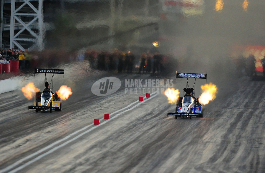 Oct. 28 2011; Las Vegas, NV, USA: NHRA top fuel dragster driver Antron Brown (right) races alongside Ron August Jr during qualifying for the Big O Tires Nationals at The Strip at Las Vegas Motor Speedway. Mandatory Credit: Mark J. Rebilas-US PRESSWIRE