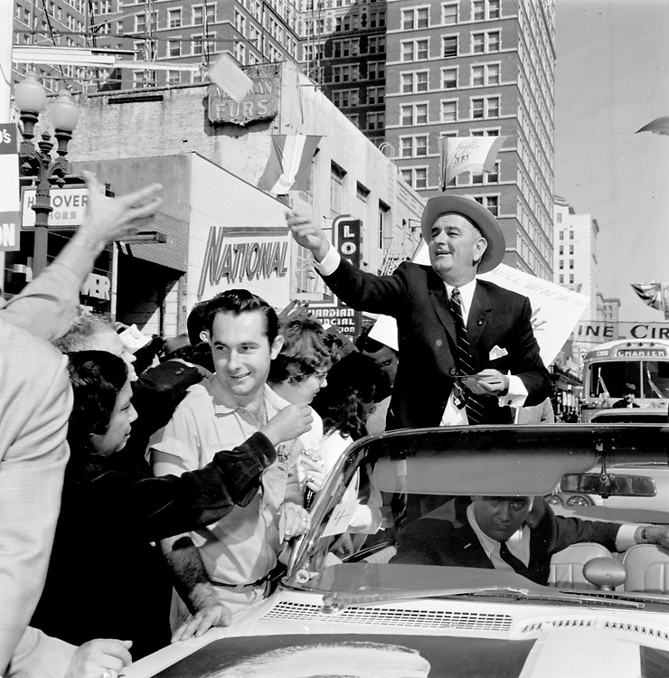 Lyndon Johnson campaigns in downtown Houston in November of 1960. Johnson sought the Democratic nomination for president aginst John F. Kennedy. When he lost to John F. Kennedy, he surprised even some of his closest associates by accepting second place on the ticket. Johnson was riding in another car in the motorcade when Kennedy was assassinated in Dallas on Nov. 22, 1963. He took the oath of office in the presidential jet on the Dallas airfield after Kennedy was pronounced dead.