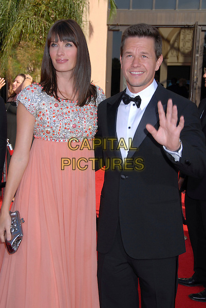 RHEA DURHAM & MARK WAHLBERG.59th Annual Primetime Emmy Awards held at the Shrine Auditorium, Los Angeles, California, USA..September 16th, 2007.half length black tuxedo jacket hand palm waving pink silver jewel encrusted dress couple clutch purse.CAP/ADM/BP.©Byron Purvis/AdMedia/Capital Pictures.