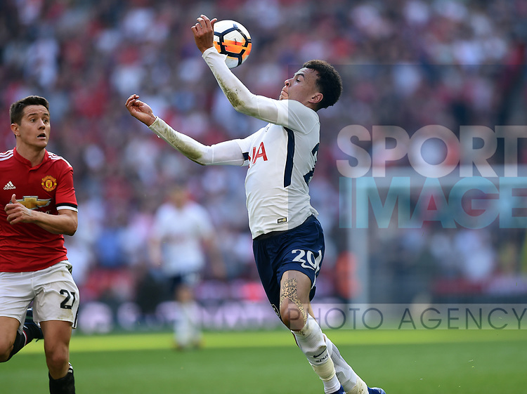 Dele Alli of Tottenham Hotspur is challenged by Ander Herrera of Manchester United during the FA cup semi-final match at Wembley Stadium, London. Picture date 21st April, 2018. Picture credit should read: Robin Parker/Sportimage