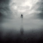 Conceptual image of a light house in the fog on a grey day