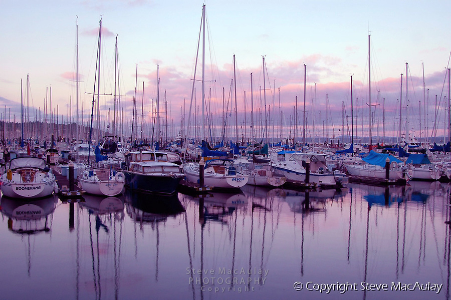 Sailboats and reflections at Golden Gardens Marina, Seattle, WA.