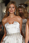 Models walk runway in outfits from the Oleg Cassini Weddings Spring Summer 2018 collection fashion show, at 15 East 63 Street on October 6, 2017; during New York Bridal Fashion Week.