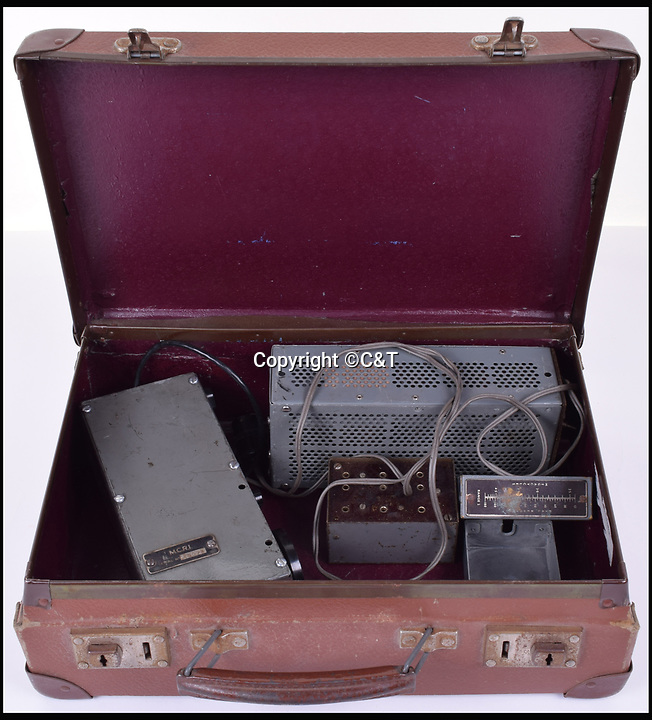 BNPS.co.uk (01202 558833)<br /> Pic: C&T/BNPS<br /> <br /> A S.O.E Secret Agents MCR-1 Biscuit Tin Radio Transmitter.<br /> <br /> A fascinating array of James Bond style concealed weapons which British spies had at their disposal in the Second World War have been unearthed and they include a pipe digger and a lethal pencil.<br /> <br /> The chilling collection consists of seemingly everyday items which, on closer inspection, conceal a deadly tool Special Operations Executive agents could turn to in a do-or-die situation behind enemy lines.<br /> <br /> The 'escape and evasion' items have been amassed by a collector of World War Two memorabilia over the years but have now emerged for auction.