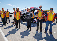Sep 4, 2016; Clermont, IN, USA; NHRA funny car driver Tim Wilkerson (center) stands with crew members as the national anthem plays during qualifying for the US Nationals at Lucas Oil Raceway. Mandatory Credit: Mark J. Rebilas-USA TODAY Sports