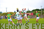 With St Kiernans having scored a goal the pressure was on and South Kerry's Garry O'Driscoll feels the pressure from St Kiernans Seamus Scanlon on the right and Kevin O'Shea as this high ball is contested.