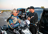 Sep 27, 2019; Madison, IL, USA; NHRA funny car driver Shawn Langdon (right) talks with John Force during qualifying for the Midwest Nationals at World Wide Technology Raceway. Mandatory Credit: Mark J. Rebilas-USA TODAY Sports