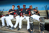 Batavia Muckdogs Shane Sawczak (33), Javier Lopez (23), Samuel Castro (25), and Pablo Garcia (7) in the dugout before a game against the Williamsport Crosscutters on September 1, 2016 at Dwyer Stadium in Batavia, New York.  Williamsport defeated Batavia 10-3. (Mike Janes/Four Seam Images)